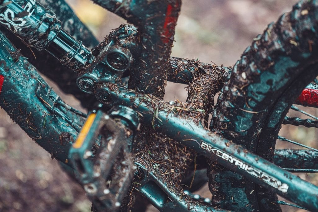 A portable pressure washer can give this dirty and muddy bike a quick washdown