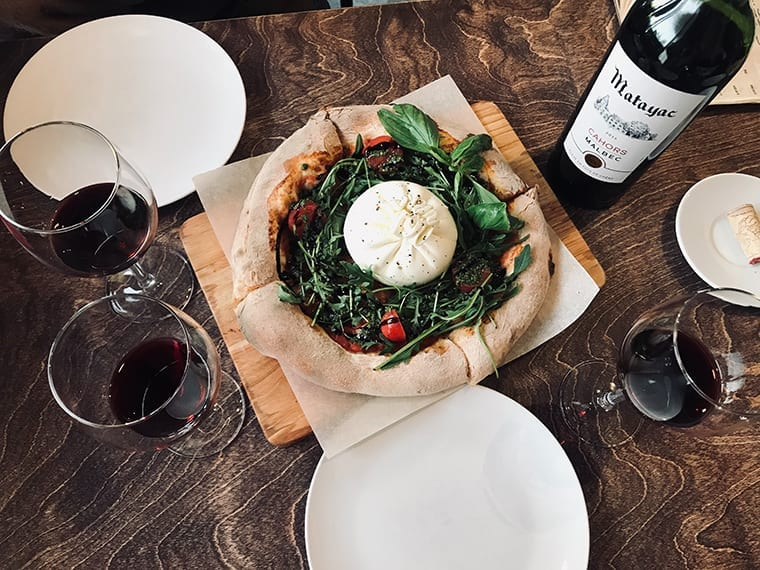 A bottle of wine completing a sumptuous lunch.