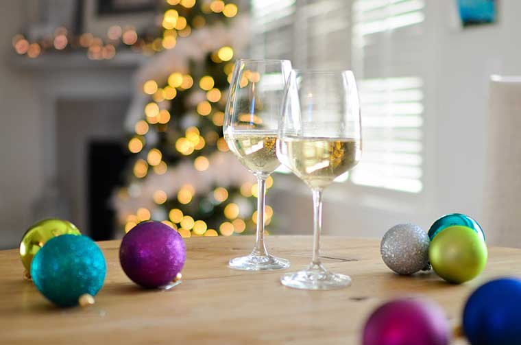 A pair of wine glasses amidst festive decorations.