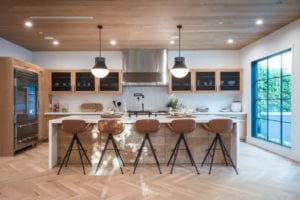 A large centre island is a striking statement and the gathering point in the kitchen.