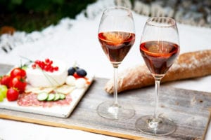 Pair of Crystal Wine Glasses Sitting on a Charcuterie Board