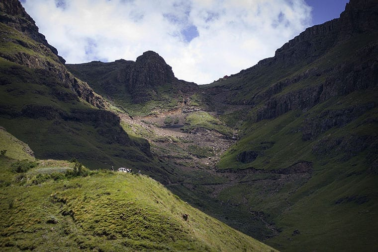 The sharp hairpin bends of the Sani Pass can be seen zig-zagging near the summit of the pass.