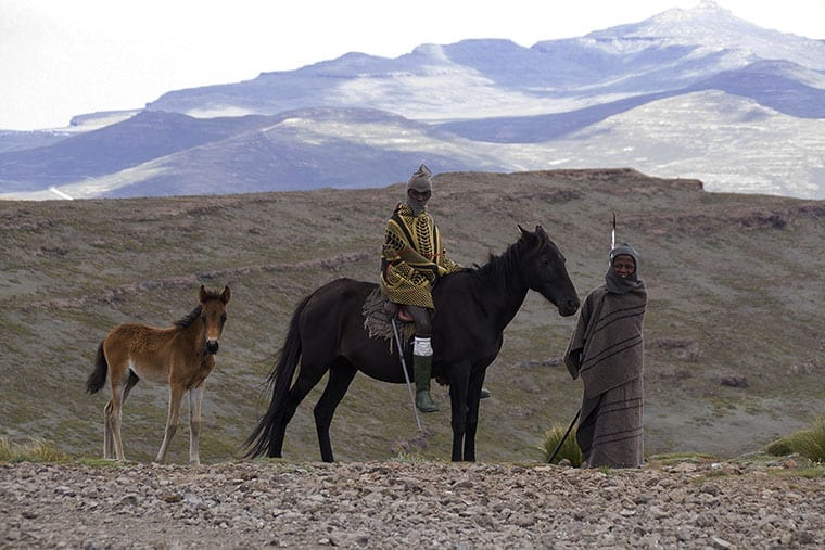 Two shepherds, each wrapped in a Basuto blanket, pose for a picture at the top of Black Mountain Pass.
