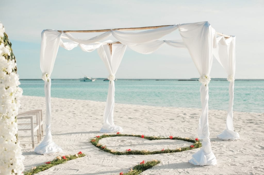 A beachfront home is the ideal location for an intimate beach wedding.