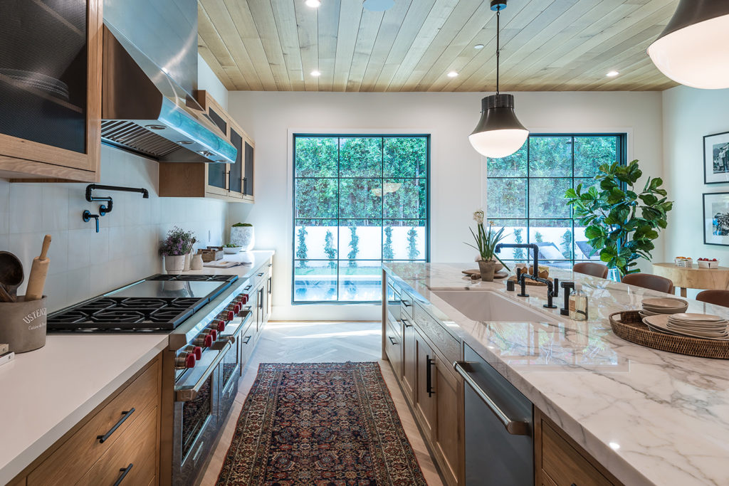 Functional Kitchen Design | Placing a sink and a dishwasher into the centre island will make for a quick clean up and easy access.